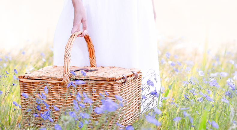 woman holding basket in flowers